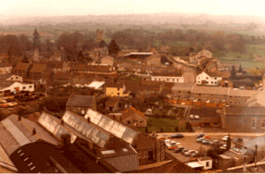 Picture taken from the water tower.  The mill cottages have been removed and the area used as a car park Cottages in the High Street are in the process of being replaced with flats and new houses (Orange fencing at rear of buildings)