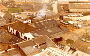 c. 1975 Another view from the water tower.  The Works Bus used for collecting employees can be seen alongside the  gatehouse.