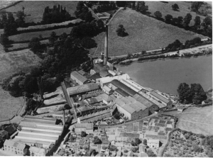 In 1935 the chimney was 220ft high. The gardens in the foreground are allotments for the mill workers The mill closed in 1961 and in 1962 a 5 year lease was taken by Prestfibre Ltd. A company from Reading producing components in wood fibre