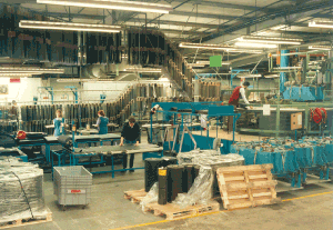 Escort Door Panel Production - Mouldings were vacuum covered and trimmed on an assembly line employing around 30 people per shift.