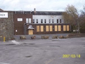 The front offices boarded up in an effort to deter vandalism.